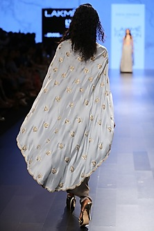 Powder Blue Embroidered Cape with Dove Grey Pleated Pants.