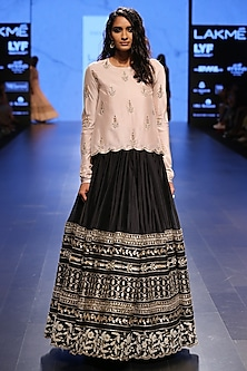Blush Silk Embroidered Raised Hem Tunic Worn with Black Silk Mul Embroidered Border Lehenga by Payal Singhal