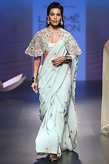 Ice blue embroidered saree with bustier and cape by Payal Singhal