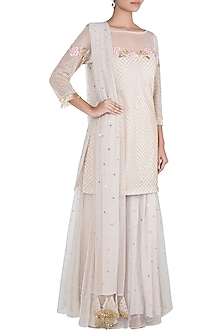 Ivory embroidered sharara set by Rishita And Mitali