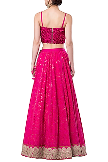 Hot pink embroidered crop top with lehenga skirt
