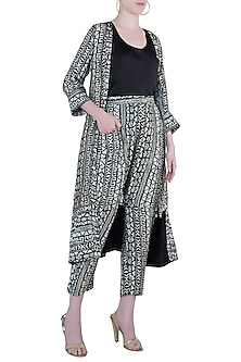 Black tribal print jacket and pant with black top by Roshni Chopra