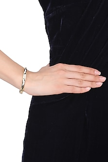 Gold plated black, white and brown narrow openable bracelet by Rosa Damascena by Shreya Jindal
