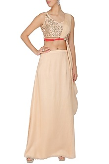 Peach embroidered drape blouse with skirt by Ruceru Couture