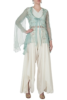 Emerald embellished jacket with ivory top and drape pants by Shreya Jalan Mehta