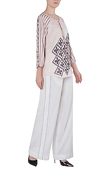 White Contrast Stitch Palazzo Pants by Saaksha & Kinni