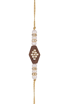 Gold Finish Pearl Rakhi With Wooden Base by SONNET