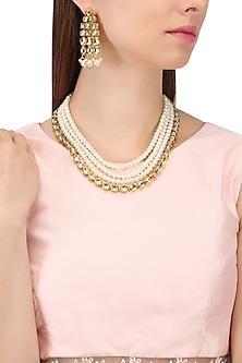 Gold Finish Layered Kundan and Pearls Necklace Set by Shillpa Purii
