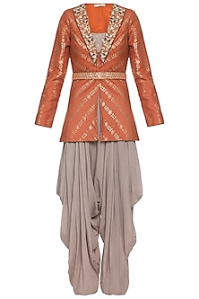 Rust embroidered foil print jacket with mud grey dhoti pants, bustier and belt