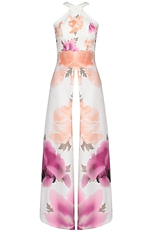 Off white lily and rose printed halter neck cape and peach trouser pants set by Shainah Dinani