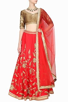 Scarlet red zardozi embroidered lehenga and copper blouse set by Sanna Mehan