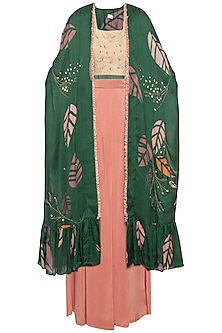 Green embroidered cape with pink top and drape pants