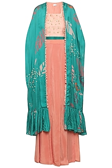 Teal embroidered cape with pink top and drape pants