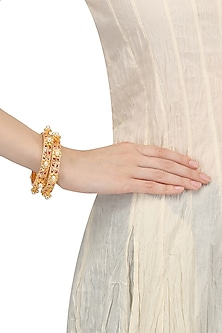 Set Of 2 Matt Gold Plated Pearl and Red Stone Bangles by Sona