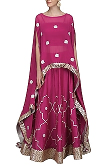 Ruby Pink Embroidered Asymmetrical Cape with Bustier and Lehenga Skirt by The Silk Tree