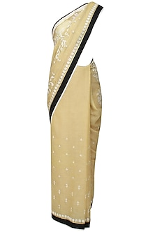 Gold and off white floral embroidered saree and quilted blouse set