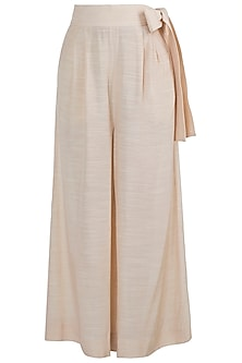 Beige flared pants with belt