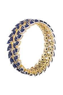 Gold plated blue sapphire bangle by Tanzila Rab