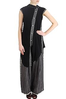 Black stitch line panel asymmetric shirt by Urvashi Kaur