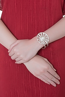 Silver plated stone wheel cuff by Valliyan by Nitya Arora