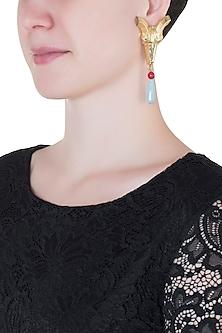 Gold plated ram head blue stone earrings by Valliyan by Nitya Arora