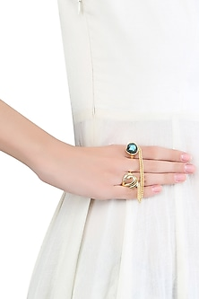 Gold plated labrodite stone two finger ring by Varnika Arora