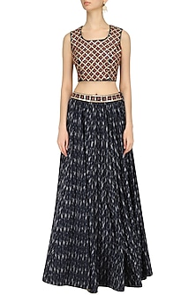 Indigo Ikkat Print Skirt and Rust Embroidered Crop Top Set by Surendri by Yogesh Chaudhary