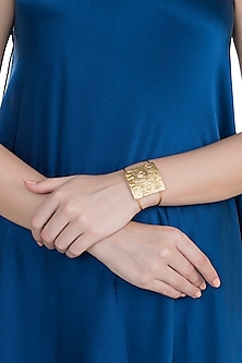 Gold Finish Handcrafted Rhino Seal Motif Cuff by ZOHRA