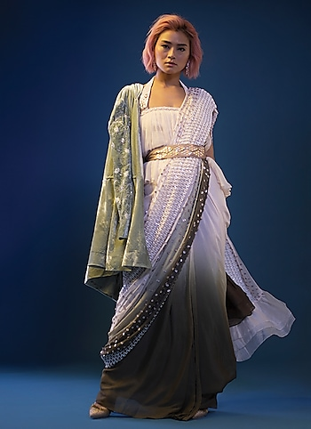 Attending a cocktail-cum-sangeet party? Throw over a jacket to layer this Pink Peacock Couture saree and cinch the waist with belt to bring your A-game forward. by Fusion Code