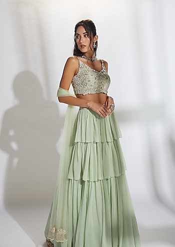 Complement the bride's glory in this dazzling contemporary lehenga by Aneesh Agarwal accentuating the look dainty jewels by Aster by Bridesmaid Spotlight