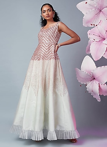 Take away the limelight as you enter the gala in this dreamy gown by Pink Peacock Couture. Complete your look with trinkets by Aster by Princessy Moments