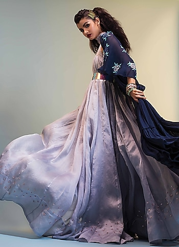 Channel your diva-esque vibes in this exquisitely crafted trapeze gown by Pink Peacock Couture layered with a breezy cape. Style the look with stacked bangles by The Bohemian for a chic flair by DRESSED TO IMPRESS
