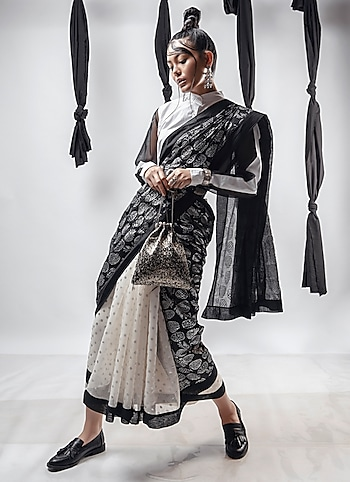 Go from retro to ravishing pairing a printed monochrome saree by Masaba with a button down by House of Sohn. Add to the drama with chic accessories. by Monochrome Mystic