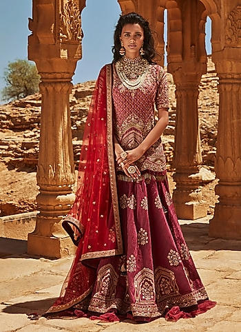 Featuring a perfect bridal look for a destination wedding at a royal palace. The opulent lehenga by Avdi is accentuated with ornaments by Just Jewellery, Riana Jewellery and Aster for a regal appeal. by THE ROYAL BRIDE