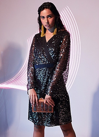 Here's a shimmer-dipped dress from Attic Salt to get your glam game on. Style the stunner with statement earrings and clutch to amp it up! by Bling Babe
