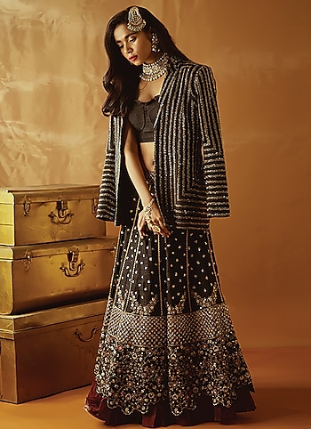 Get ready for the festivities in this bewitching black lehenga set by Nadima Saqib. Layer it up with a statement blazer from Zwaan for an added edge. Punctuate the look with some vintage jewellery pieces by Tradition meets Modern