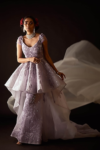 Enter like the belle of the ball in this couture gown by Amit GT. Pick exquisite jewels from Aster to add some bling to your look by Couture Excellence