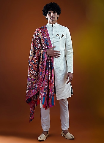 Featuring a sherwani by Mitesh Lodha, paired with a meticuloudly designed shawl by Nieza Shawls to accentuate the royal within you on the wedding day. by The Royal Groom