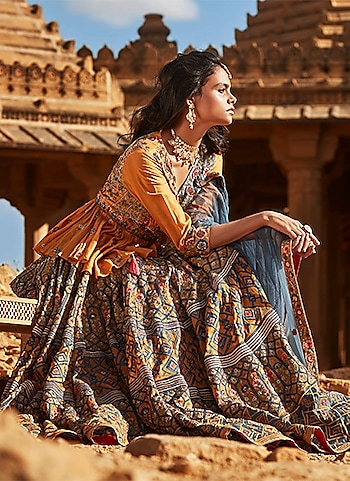 A bohemian bridal lehenga by Samant Chauhan meticulously crafted a tribal-inspired ornate. Adorn the look for pre-nuptial traditions to accentuate your bridal glow. by THE BOHEMIAN BRIDE