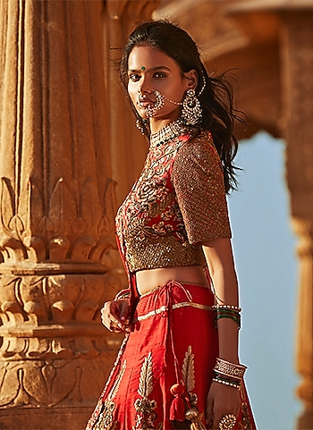 Featuring a traditional red bridal ensemble by Samant Chauhan primped with rich gold embroidery. The look is punctuated with a traditional vintage nose ring and necklace set by Riana Jewellery. by THE QUINTESSENTIAL BRIDE