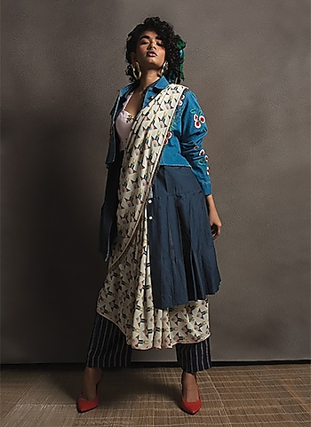 Add a distinct appeal to your casuals draping a chic printed saree. Play with tonal patterns and multiple layers to ace an uber-stylish look. by THE WEEKENDER