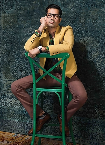 Sumeet Vyas oozing flamboyance and suave in an ikat shirt by KOS teamed with a jacket and pants by Dhruv Vaish. by URBAN ALLURE