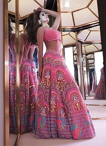 Cast a spell on the onlookers with this illuminous lehenga ensemble. It is a perfect choice to create a dramatic flutter at a sangeet-cum-cocktail night. by STEAL THE SPOTLIGHT